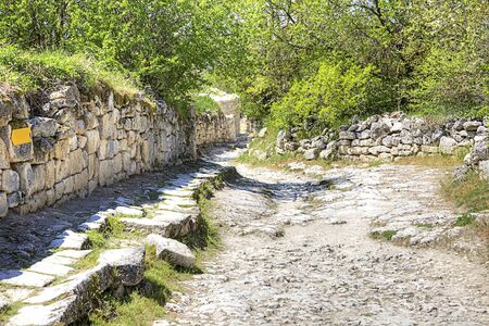 saved: Saved part of road with the pavement of medieval city Chufut-Kale. Crimea. Stock Photo