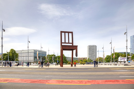 broken chair: SWITZERLAND, GENEVA - May 06.2014: Enormous broken chair on Area of Nations before the representative office of the UN office. Symbol of prohibition of personnel mines and cassette bombs