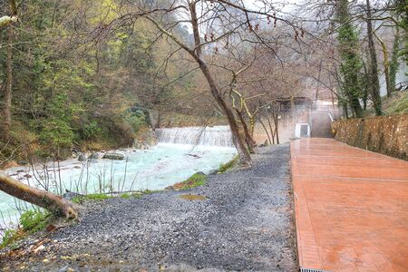 radon: River Termopotamos. Embankment of the river next to the thermal spring