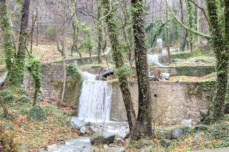 radon: Termopotamos River. Cascade of artificial waterfalls on the mountain Voras by the thermal source