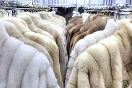 well made: Showroom coats with fur factory Stock Photo