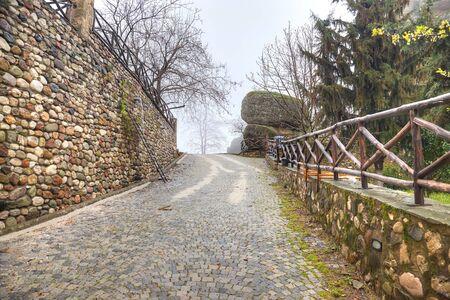 thundershower: Road in monastery on the top of rock in a monasterial complex Meteora