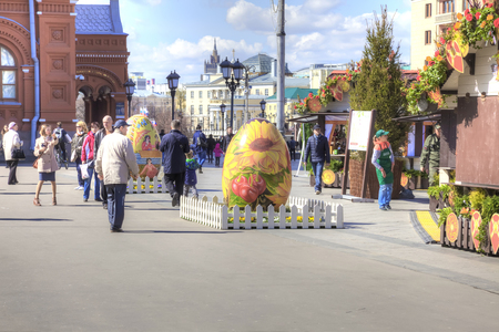 sightseers: MOSCOW, RUSSIA - April 24.2016: The great Easter egg on a festive fair in the city center