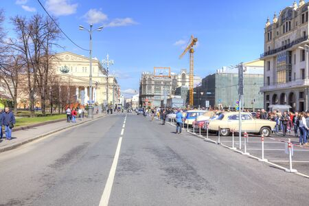 sightseers: MOSCOW, RUSSIA - April 24.2016: City landscape. Theatre Square, vintage car exhibition, Bolshoi Theatre and Petrovka Street Editorial