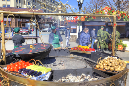 urbanite: MOSCOW, RUSSIA - April 24.2016: Open-air cafe. Enormous frying pan, mangal and fresh vegetables