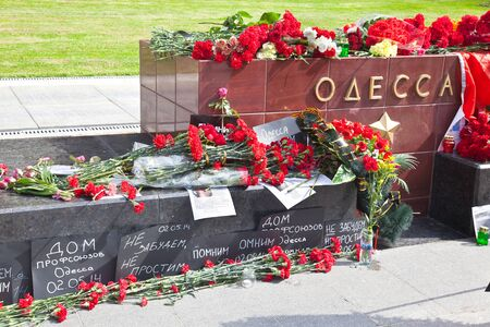 not forget: MOSCOW, RUSSIA - May 02.2016: Memorial complex of Cities of Heroes near the Kremlin wall. Stele Odessa. Inscriptions Remember, Do not forget, Do not forgive