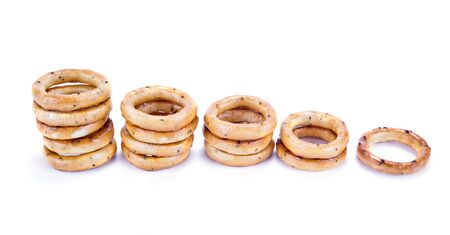 strewed: Little bagels with a poppy, it is isolated on a white background