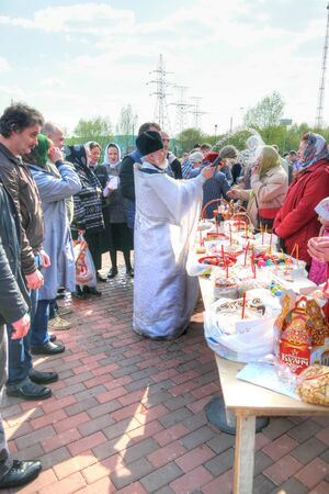 sanctification: MOSCOW, RUSSIA - May 01.2016: Priest blesses Easter cakes and eggs on the eve of the Easter holiday