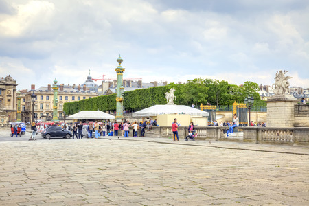 urbanite: PARIS, FRANCE - April 30.2014: Tourists and citizens on the Place de la Concorde in historical part of city Editorial