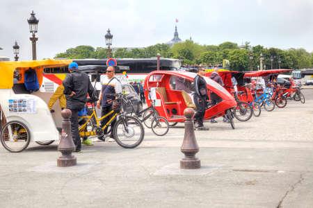 trishaw: PARIS, FRANCE - April 30.2014: Trishaw waiting of customers on the Place de la Concorde