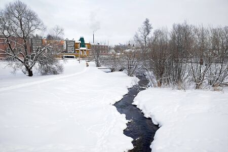 very cold: SERGIYEV POSAD, RUSSIA - January 02.2010:  River Konchury with very cold water, which is shifted even in cold weather. Sergiyev Posad Editorial