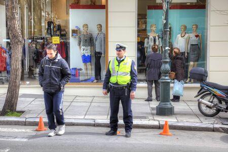 THESSALONIKI, GREECE - March 17.2016: A policeman keeps order on a city street