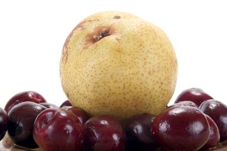 gean: Pear and ripe berries are isolated on a white background