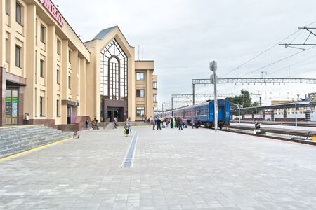 embark: GOMEL, REPUBLIC BELARUS - June 19.2016: The citys railway station. Passengers expect to embark on a train