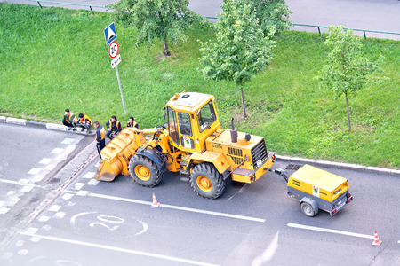 MOSCOW, RUSSIA - August 14.2016: Brigade of workers of municipal service repairs a transition across the motor-car road