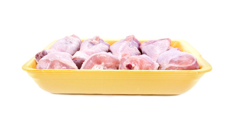 Packaging with chilled chicken drumsticks isolated on white background Stock Photo