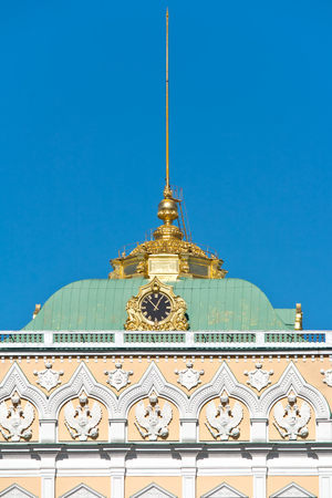 sceptre: Fragment of facade of the Grand Kremlin Palace with the coats of arms of Russia and chimes