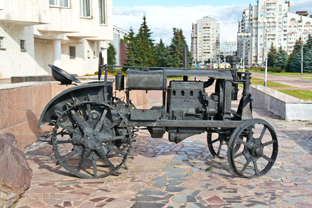 municipal: BELGOROD, RUSSIA - August 31.2016: Restored old Soviet tractor. Exhibit of the municipal Local museum