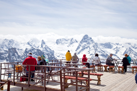 DOMBAY, RUSSIA - May 03.2015: Interior of verandah of alpine cafe on mountain Mussa-Achitara. People admire mountains