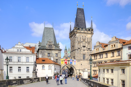 passerby: PRAGUE, CZECH REPUBLIC - May 06.2012: Entrance to the Charles Bridge over the Vltava river