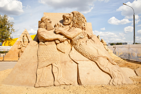 MOSCOW, RUSSIA - August 18.2013: Exhibition of sculptures made of sand in Kolomenskoye city park. Sculpture Assyria