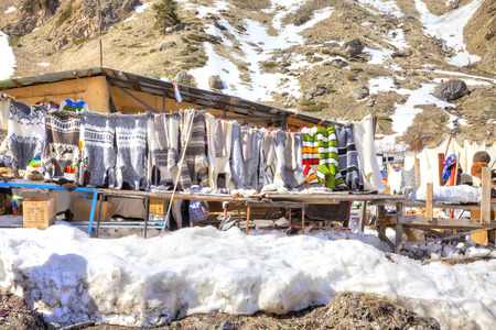 warm things: CAUCASUS, RUSSIA - May 01.2015: Sale of warm things on the glade of Azau in the settlement of skiers at the foot of mountain Elbrus