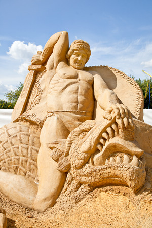 MOSCOW, RUSSIA - August 18.2013: Exhibition of sculptures made of sand in Kolomenskoye city park. Battle of Siegfried with a dragon Fafnir Editorial
