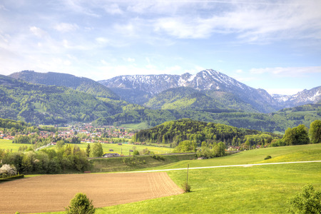 foothill: Picturesque suburb of city Salzburg are in the foothill of the Alps