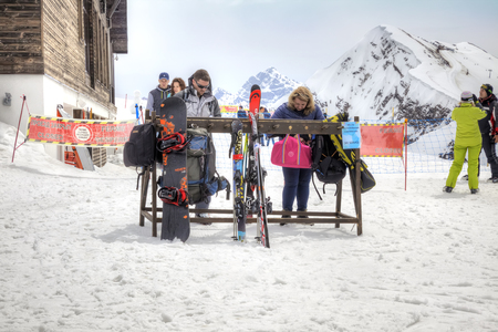 frostily: SOCHI, KRASNAYA POLYANA, RUSSIA - April 29.2015: Place of maintenance of ski equipment. People sort out things in bags and backpacks. Mountain Rose Plateau. Vertex Editorial