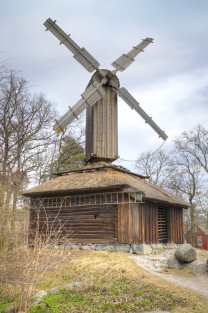 ethnographic: STOCKHOLM, SWEDEN - May 04.2013: Ethnographic complex the open air museum Skansen, located on Djurgarden Island in Stockholm. Mill