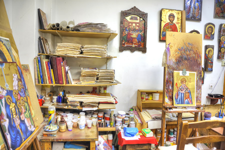 inwardly: METEORA, GREECE - March 13.2016: Ready icons and designs in the icon masterful of souvenir shop