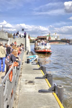 MOSCOW, RUSSIA - May 02.2016 : People on moorage on Prechistenskaya of embankment in expectant of excursion steamship