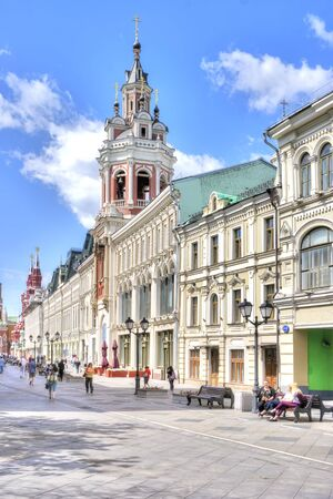 MOSCOW, RUSSIA - July 08.2015: Nikolskaya Street. Facades of ancient mansions and bell tower of the Monastery of St. Nicholas