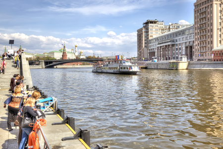 sights of moscow: MOSCOW, RUSSIA - May 02.2016 : People on moorage on Prechistenskaya of embankment in expectant of excursion steamship