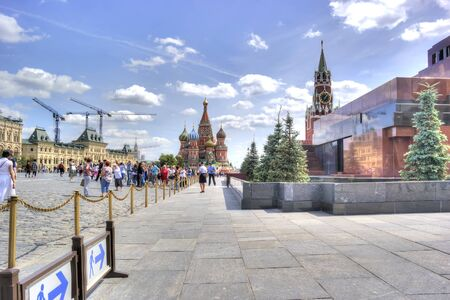 spasskaya: MOSCOW, RUSSIA - July 08.2015: Mausoleum of Lenin, Kremlin and St. Basils Cathedral on Red Square in the historic center of city