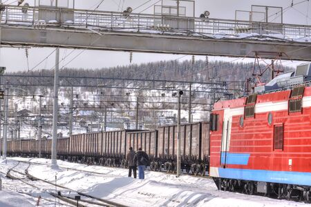 frostily: MURMANSK, RUSSIA - March 27.2009: Freight trains at a railway station of the city of Murmansk