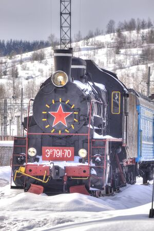 frostily: MURMANSK, RUSSIA - March 27.2009: Railway station. Old steam locomotive on the siding Editorial
