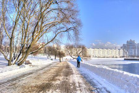 frostily: MINSK, REPUBLIC OF BELARUS - January 18.2017: City landscape. Svislach river bank in the city center