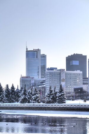 frostily: MINSK, REPUBLIC OF BELARUS - January 18.2017: Office buildings on the riverside of the Svislach River in the city center.