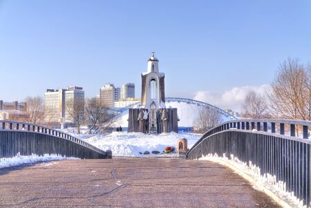 frostily: MINSK, REPUBLIC OF BELARUS - January 18.2017: The bridge to the island of Courage and Sorrow monument to the Soldiers-Afghanistan