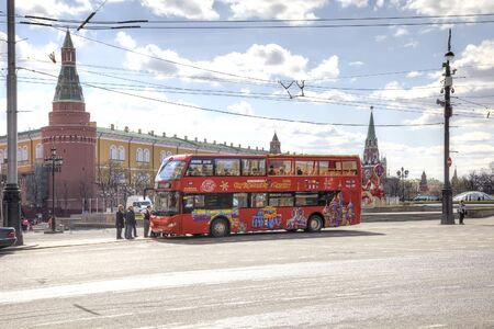 sights of moscow: MOSCOW, RUSSIA - April 24.2016: Red sightseeing bus stopped at the Theatrical Square in anticipation of tourists