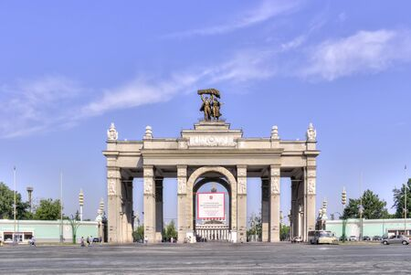 sights of moscow: RUSSIA, MOSCOW - May 27.2014: Arch of main entrance on an exhibition complex VDNKh (Russia) Stock Photo