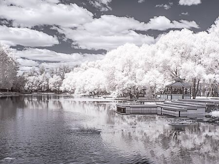 City landscape. Arbor on the shore of the Italian pond. Moscow city. Infrared photography