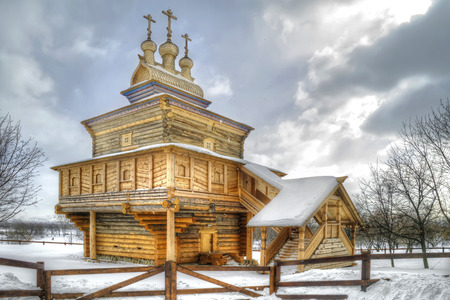 MOSCOW, RUSSIA — March 06.2011: Museum of Wooden Architecture, Kolomenskoye. St George the Victorious Church, 1685. Snowfall Editorial