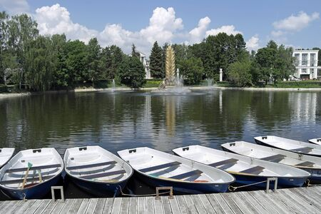 MOSCOW, RUSSIA - May 28.2014: Exhibition of Achievements of the Peoples Economy (VDNKh). Boats on the shore of the pond Editorial
