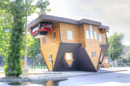 MOSCOW, RUSSIA - May 28.2014: Exhibition of Achievements of National Economy. Unusual house. the turned house - a unique interactive attraction Editorial