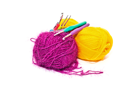 Multicolored wool yarn and a set of hooks for knitting isolated on white background