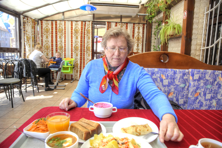 KALININGRAD, RUSSIA - May 04.2018: Complex lunch at the city cafe. A woman is sitting at a table in a cafe