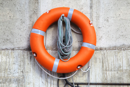 Rescue on the water. Lifebuoy on the pier wall