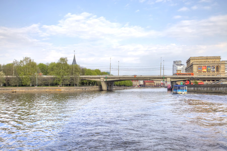 KALININGRAD, RUSSIA - April 28.2018: The ancient building of the former stock exchange in the city of Königsberg, the watercourse of the Pregola River and the Green Bridge